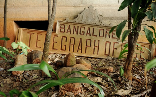 A derelict name board for the Bangalore Telegraph office lies on the ground outside the telecommunications office